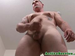 Solo army stud with tattoos wanking his hard cock
