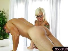 Blonde tattooed masseuse sucks off good under the table