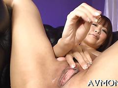 Asian milf loves fingering her wet pussy
