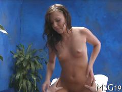 Brunette bitch has a hot fuck on a massage table