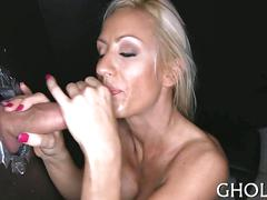 Tattooed up blonde gets doggy style fucked in the gloryhole