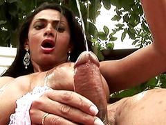 Fruit eating shemale with massive boobs strokes her shecock