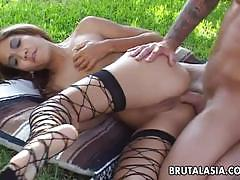 Asian babe fucked outdoors