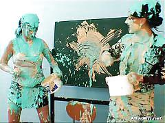 Lesbians play with paint