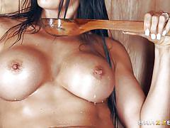 Sexy milf with huge boobs gets a mouthful in the sauna