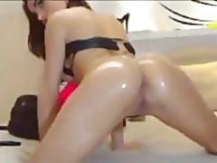 Brunette teasing her oily ass