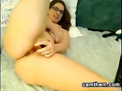 Thick and busty nerd masturbates