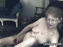Four eyed old whore rubs her pussy in stockings