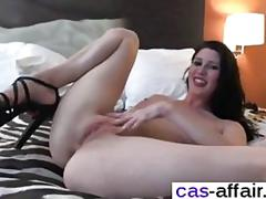 Lady in red rubs her pussy and flashes her big tits