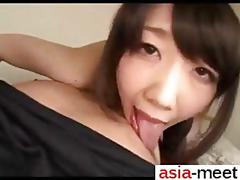 Asian babe gets something big and hard to suck on