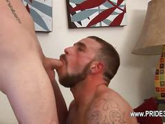 Bearded hunk devours dick and gets nailed doggy style