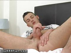 Jerking the cock so the cum starts shooting out