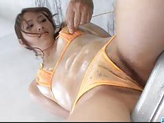 Asian babe gets her pussy toyed