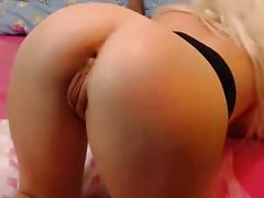 Hot blonde plays with a dildo and fucks herself in both