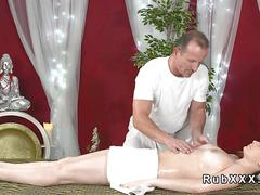 Masseur fucks brunette after massage