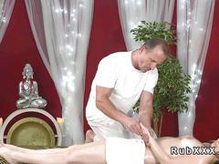 Masseur fucks brunette after massage