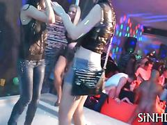 Soaking wet party girls dance and tease in a club