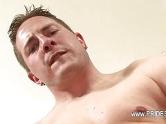 Tattooed stud works his shaved boner butt naked