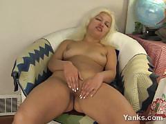 Amateur blonde rubs her moist slot