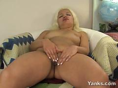 Amateur blonde rubs her moist slot
