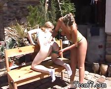 Busty teen gets toyed in the sun by a lesbian babe