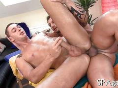 Tattooed masseur bangs his straight client right in the ass