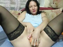 Milf fucks herself with a bottle, zucchini and makes fisting. squirt