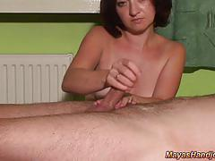 Luscious brunette jerks this hard cock