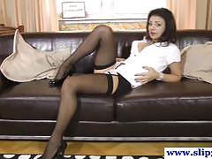 Stockings clad brunette rubs her moist slot