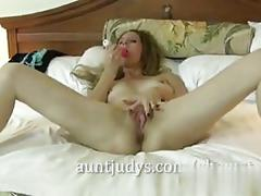Amateur blonde with her pink toy drills her wet pussy