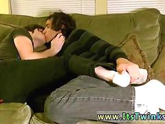 Two twinks make out and play with their feet on the couch
