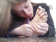 Kinky girl playing with feet
