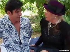 Granny fucks outdoor