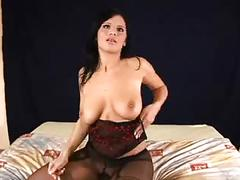 Hot brunette in black pantyhose in hot action