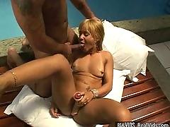 Tanned blonde anal fucked near pool