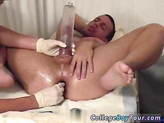 Placing a dick pump over his erect pecker