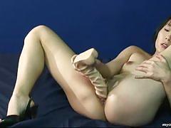 Japanese brunette toys her moist pussy