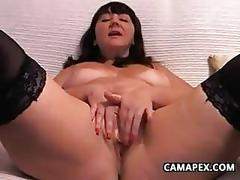 Large mature woman masturbating