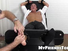 Jacob is tied up to a chair and loves to get his toe tickled