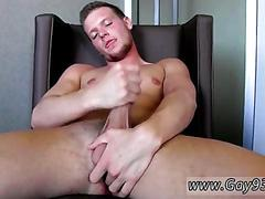 Bearded dude rubs his twink cock in a leather chair
