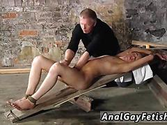 Skinny twink gets oiled up in bondage and jacked off