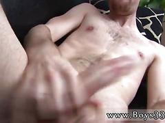 Skinny college guy plays with his rock hard cock on the couch