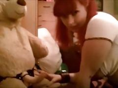 Submissive school girl rides her teddy