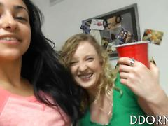 Curly college blonde parties with her friends in a dorm room
