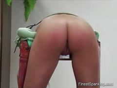 Hardcore spanking of round ass
