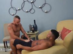 Tattooed dude gets a big hard cock to suck on