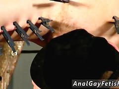 Twink covered in clothes pins and dominated with bondage