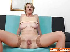 Mature cougar toys her moist pussy