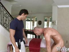 Big white stud massaged and fucked by a black hunk