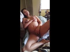 Squirting pregnant beauty plays with her pussy